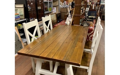 Modern solid wood dining table with 4 matching chairs.