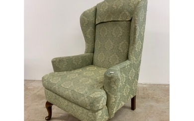 Queen Anne style wing back arm chair in green upholstery