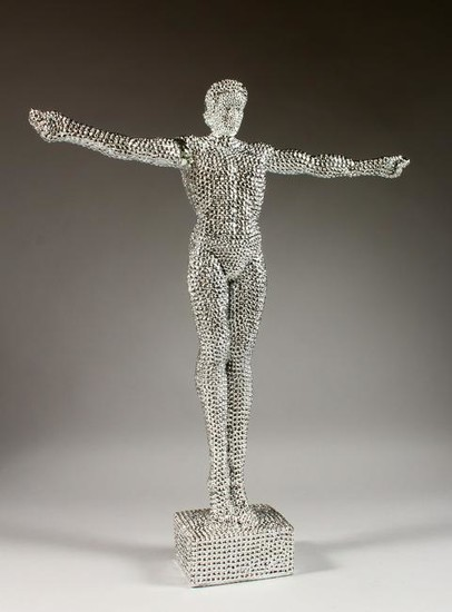 THE GLITTER MAN, a standing figure with arms