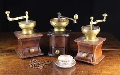 Three Vintage Brass Coffee Grinders; each having a wooden box form base with brass handled drawer.