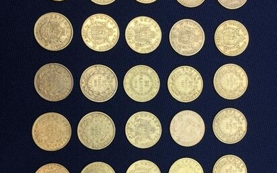Twenty-five 20-franc gold coins and two 10-franc gold...