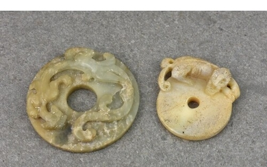 Two Chinese carved jade Pi discs, probably 19th century, the...