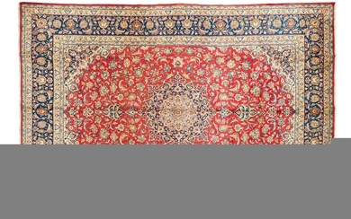 Very important Esfahan najafabad. ( iran ) circa 1980 Dimensions. 510 x 345 cm Technical specifications. Wool velvet on cotton foundations Good general condition Density approx. 7000 knots per dm2 Ruby field with foliage and garlands of flowers framing...