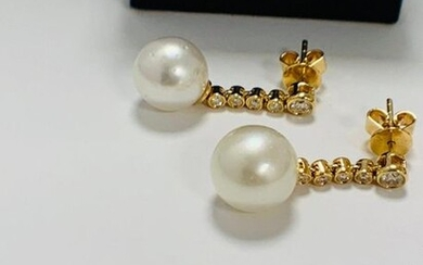 14ct Yellow Gold Pearl and Diamond earrings featuring,...