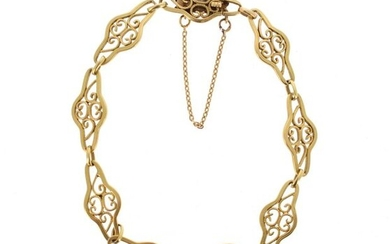 18 K (750 °/°°°) yellow gold bracelet with openworked and filigree links.