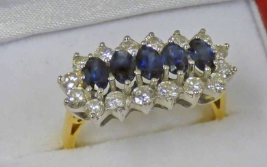 18CT GOLD SAPPHIRE & DIAMOND CLUSTER RING, THE 5...