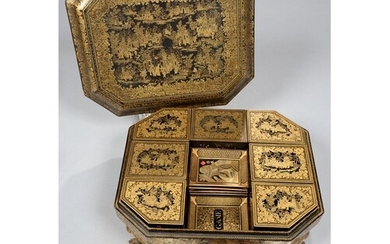 A CHINESE EXPORT BLACK AND GOLD LACQUER GAMES BOX AND COVER,...