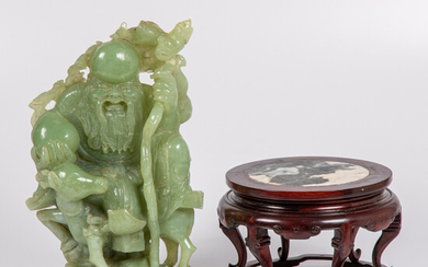 A Chinese Carved Celadon Jade Figural Group