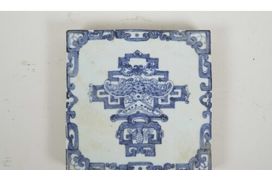 A Chinese blue and white porcelain tile decorated with a sty...