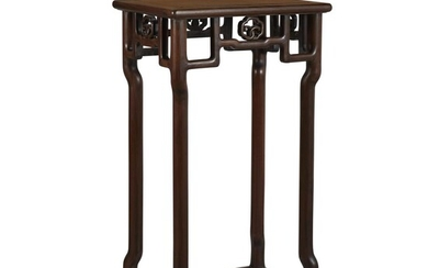 A Chinese carved hardwood stand Late Qing dynasty With...