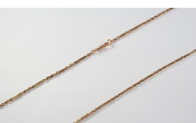 A GOLD WATCH CHAIN formed with long and short links, 66cm lo...