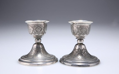 A PAIR OF RUSSIAN SILVER DWARF CANDLESTICKS, EARLY 20TH