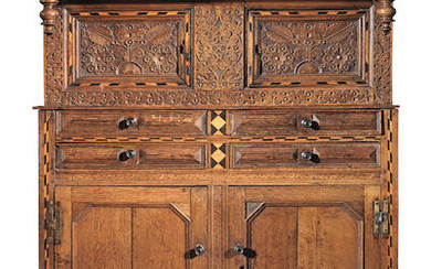 A Queen Anne joined oak and inlaid press cupboard, Lancaster area, dated 1712