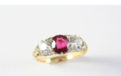 A RUBY AND DIAMOND THREE STONE RING the oval-shaped ruby wei...