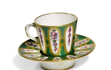 A SEVRES PORCELAIN GREEN-GROUND CUP AND SOCKETED SAUCER, 1768