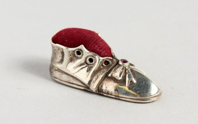 A VICTORIAN STYLE SILVER OLD BOOT PIN CUSHION.