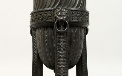 A WEDGWOOD BLACK BASALT URN, with lion ring handles, on
