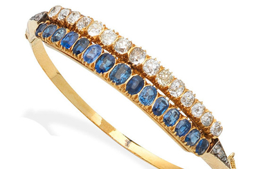 A late 19th century sapphire and diamond bangle