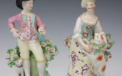A pair of Derby porcelain figures, late 18th century, modelled as a girl with a lamb and a boy holdi
