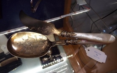 A pair of French Meritz gilded silver spoon and knife