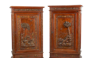 A pair of continental parcel gilt and carved walnut cabinets