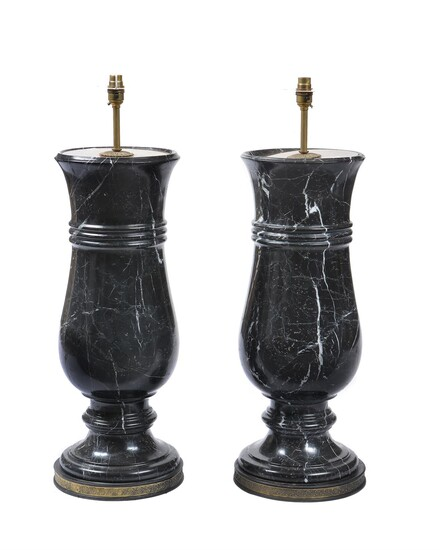 A pair of substantial black and white veined marble and gilt metal mounted table lamps
