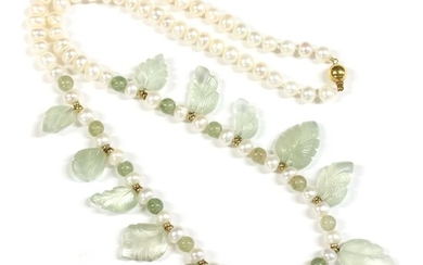 A single row carved bead and freshwater cultured pearl necklace