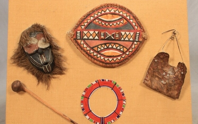 """AFRICAN ARTIFACTS MOUNTED ON BURLAP PANEL, H 32"""", W 43"""""""