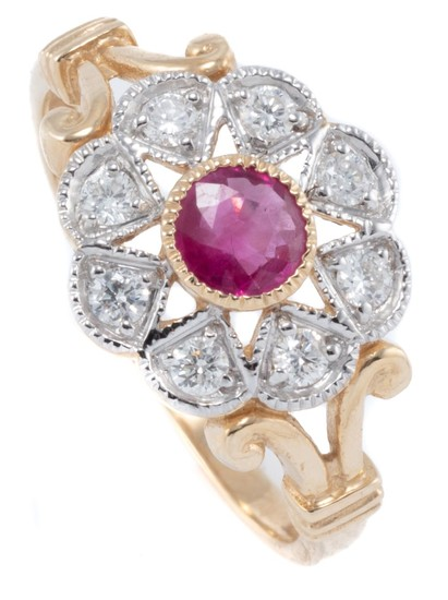 AN EDWARDIAN STYLE RUBY AND DIAMOND CLUSTER RING; set in 9ct gold with central round cut treated ruby to surround of 8 round brillia...