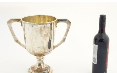 An Art Deco large silver pedestal trophy cup with twin handl...
