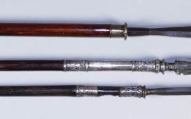 An Indo-Persian Spear, the hardwood shaft with silvery metal...