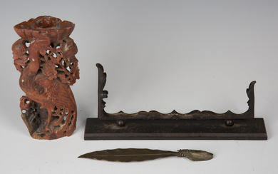 An early 20th century bronze letter opener, finely modelled in the form of a cicada eating a leaf, l