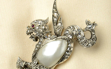 An early 20th century silver and gold, blister pearl, rose-cut diamond and ruby brooch, depicting a mythical creature.