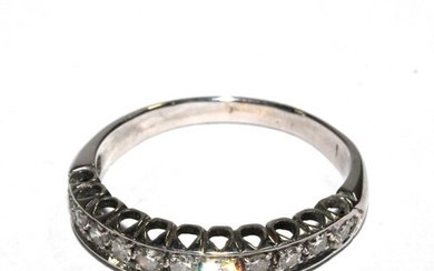 An eleven stone half eternity ring set in white colour metal