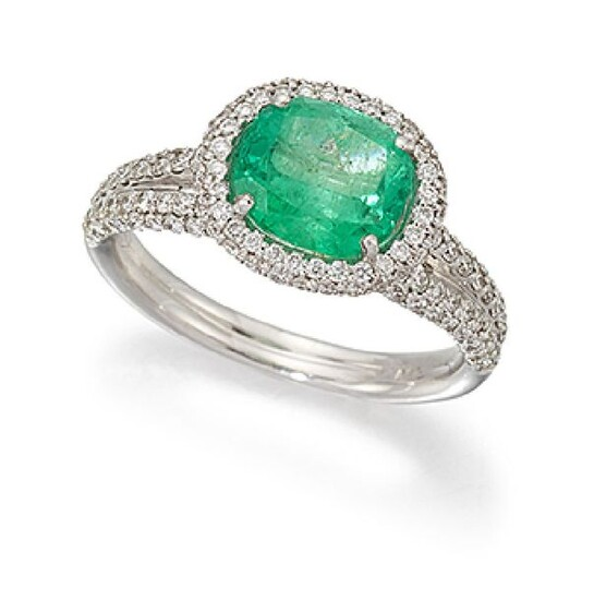 An emerald and diamond cluster ring, the cushion...