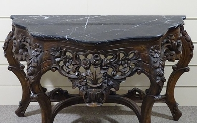 An ornate Rococo style carved walnut console table with shap...
