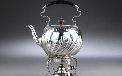 Charles Stuart Harris. Victorian sterling silver teapot in rococo form with stand, London, 1885