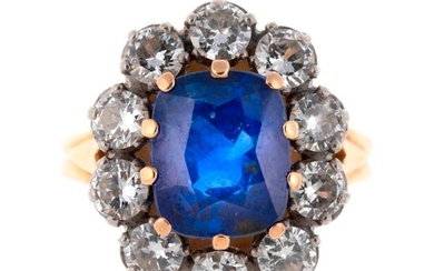 Gold and platinum pompadour ring centered on an unheated Ceylon sapphire of about 3 carats in a diamond setting totaling about 1 carat - Gross weight: 7.8 g - Photocopy of a notice from the Gem Gemological Laboratory of Paris concerning the origin of...