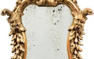 Mirror with an animated shape in carved and...