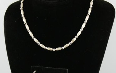 Modern Silver Bead Necklace and Hoop Earrings