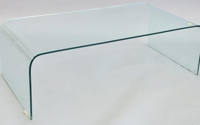 Modern curved glass coffee table, surface scratches