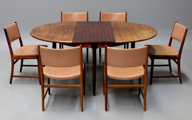 N.O. Møller & Kai Lyngfeldt Larsen. Dining table in rosewood with concealed extension leaves as well as six rosewood chairs (7)