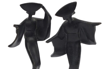 Pair of Japanese Modernist iron figures, the largest 18cm hi...