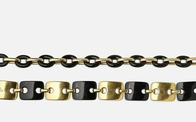 Pair of black onyx and gold bracelets