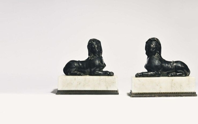 Pair of plaster sphinxes with a patina in imitation of bronze. They rest on a white veined marble terrace and a base (with small gills) decorated with a partially gilded metal frieze. Neoclassical work H : 26 cm L : 28,5 cm Depth : 13 cm H of the...