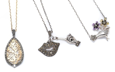 THREE SILVER MARCASITE PENDANT NECKLACES; pendants Victorian style hand with flowers, 'Shhhh lips' and silver gilt floral cut out, a.