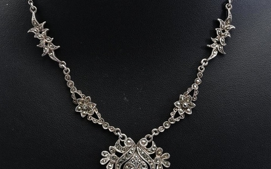 TWO MARCASITE NECKLACES AND TWO PAIRS OF EARRINGS IN SILVER