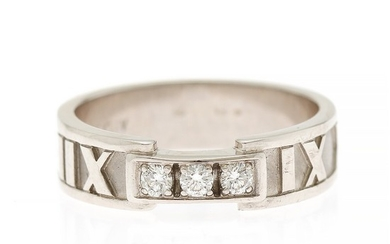 """Tiffany & Co.: An """"Atlas"""" diamond ring set with three brilliant-cut diamonds totalling app. 0.12 ct., mounted in 18k white gold partly with a satin finish."""