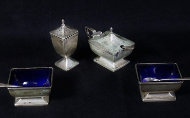 Two salt shakers and salt shovels, a pepper and mustard maker. A cream ladle and teaspoons are attached. Silver 800 mils minimum English work. Weight of the set 320 g.