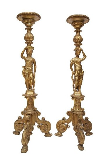 197-Pair of torchieres in carved stuccoed and gilded wood decorated...